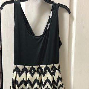 NWT. Cute black open back dress.